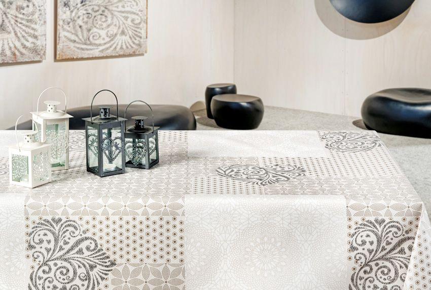 Verspielte Muster-Kombinationen in dezenten Farbtönen gleichmäßig über den Tischbelag verteilt